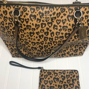 Coach cheetah print purse with matching wristlet